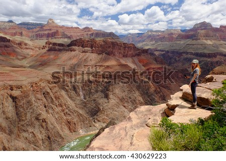 A Hiker In The Grand Canyon of The Colorado River.  Grand Canyon National Park, South Rim, Arizona - stock photo