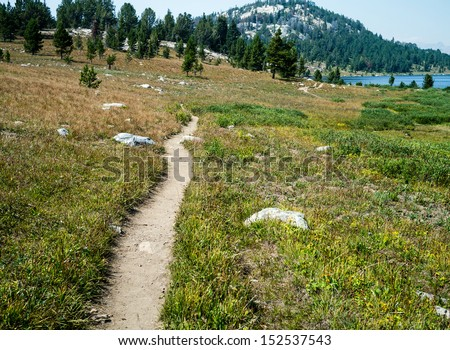 A hiking trail in the mountains. - stock photo