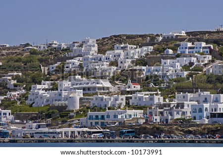 A hillside in Mykonos, Greece covered with white mediterranean houses. - stock photo