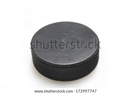 A hockey puck on a white background - stock photo