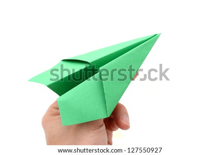 A holding origami plane - stock photo