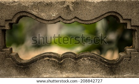 A Hole in a Wall with green bokeh - stock photo