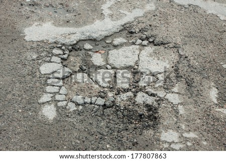 A hole in the asphalt road - stock photo