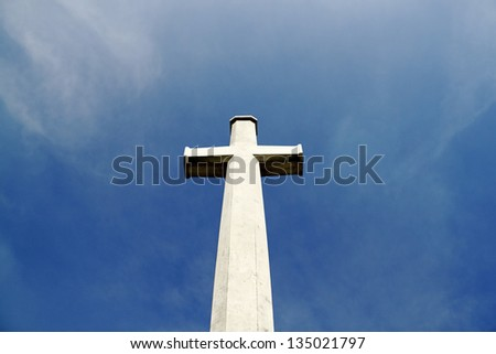 A holy christian crucifix against a dreamy blue sky. - stock photo