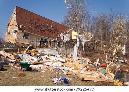 A home heavily damaged by an F2 tornado that swept through Oregon Twp in Lapeer County, MI on March 15, 2012. The house was lifted from its foundation. This photo was taken the next day. - stock photo