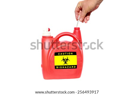 A home made Needle and Sharps Disposal Container made from an old laundry soap dispenser. isolated on white with room for your text. Used needles are a Bio Hazard and need to be disposed of correctly. - stock photo