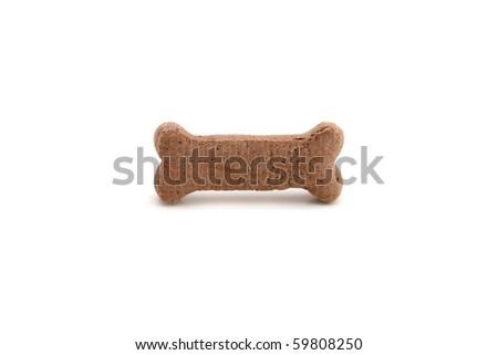 A horizontal color photograph of a single dog biscuit over a white background. - stock photo