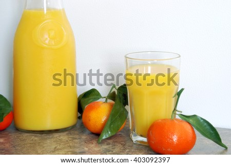A horizontal image of a one litre pitcher of refreshing citrus juice blended for a good start to a healthy morning routine. - stock photo
