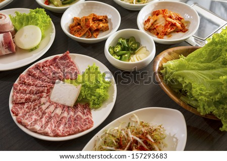 A horizontal shot of beef with korean side dishes. - stock photo