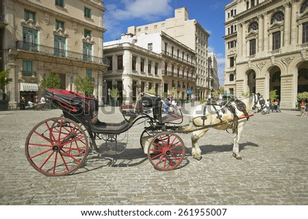 A horse and carriage in the plaza of Old Havana, Cuba - stock photo