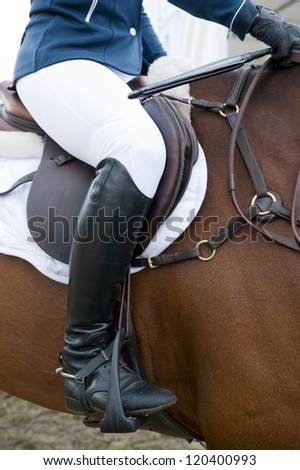 A horsewoman ready for a equestrian competition. - stock photo