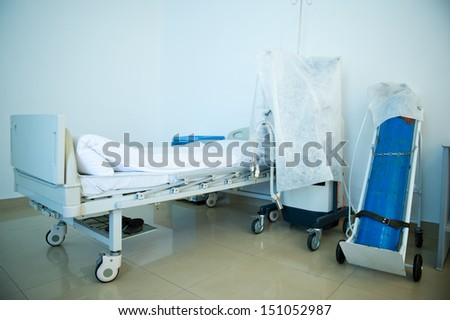 A hospital bed waiting the next patient. - stock photo
