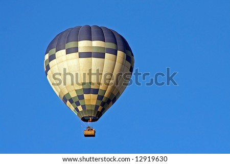 A Hot Air Balloon on a clear morning flight - stock photo