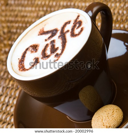 A hot cappuccino with an amaretti - stock photo