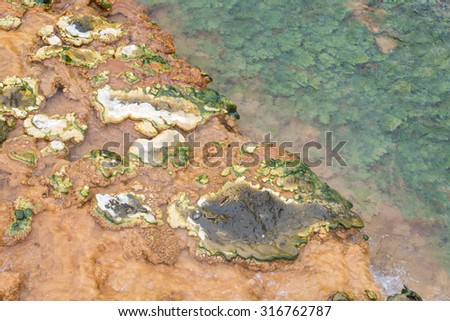 A hot spring in Iceland.  Geothermally heated groundwater. Iceland. - stock photo