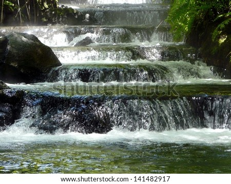A hot spring provides warm water the Arenal volcano in Costa Rica - stock photo