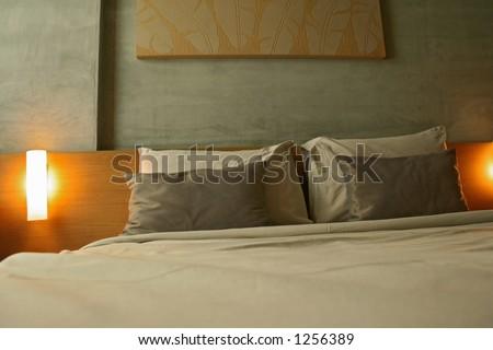 a hotel bedroom - stock photo