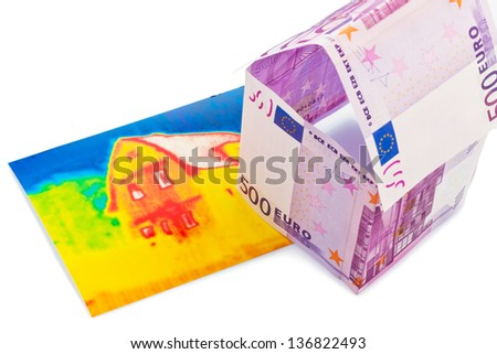 a house built out of euros and money seem an infrared image. building society, building houses and buying a house. - stock photo