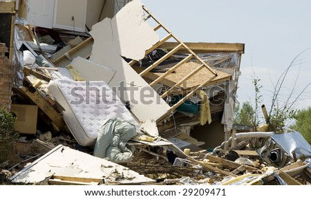 A house in a residential neighborhood, completely destroyed by a tornado - stock photo