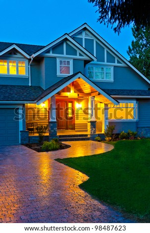 A house in suburbs at dusk ( night ) in Vancouver, Canada - stock photo
