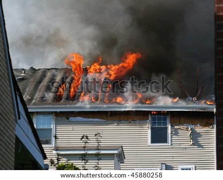 A house on fire. - stock photo