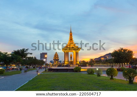 A HUGE bronze statue of the late King Father Norodom Sihanouk Statue in a park alongside a boulevard bearing Sihanouk�s name at Phnompenh, Cambodia - stock photo