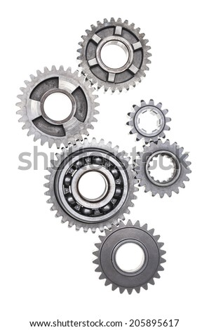 A huge group of metal gears linked together on a white background - stock photo