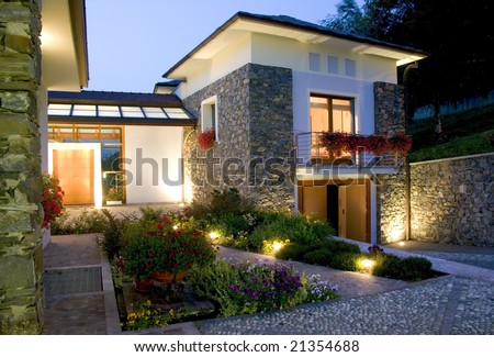 A huge new luxury home at sunset - stock photo