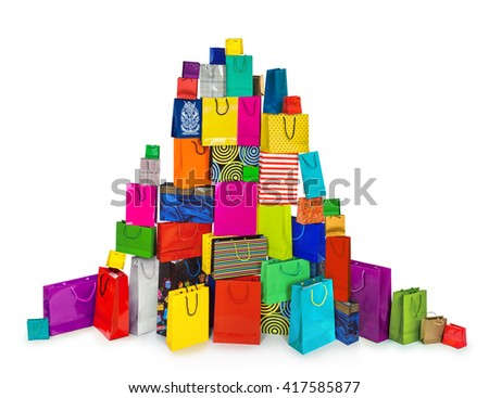 a huge pile of multi-colored bags for shopping isolated on white background - stock photo