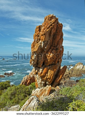 A huge red stone lying on the beach. With beautiful sky. Africa, landscape - stock photo