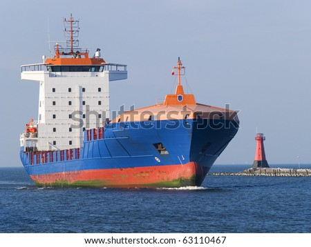 A huge ship leaving a harbour - stock photo