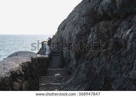 a huge staircase in the rock - stock photo