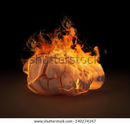 A human head sculpture in flames - stock photo