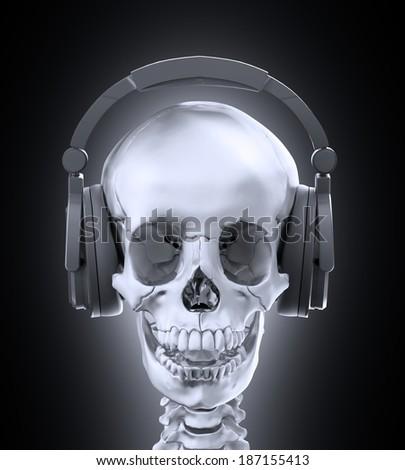 A human skull wearing headphones - stock photo