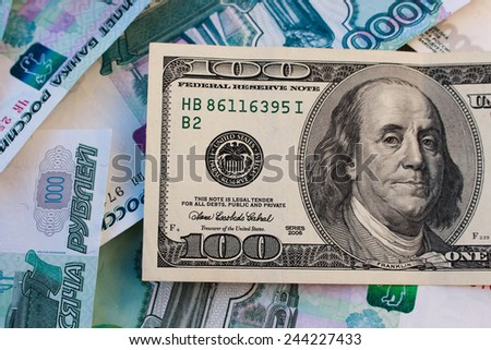 A hundred dollar bill on the background of Russian roubles - stock photo