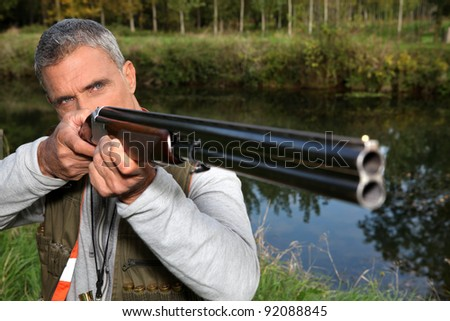 a hunter aiming for a target - stock photo