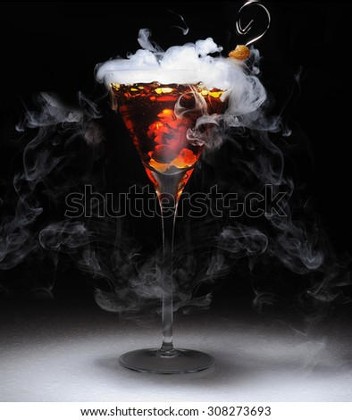 a impressive cocktail  with dry ice,color and transparent with dark lighting and shadows - stock photo