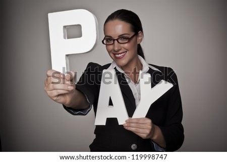A income concept image of a woman holding letters that spell out the word pay demonstrating fare pay for woman. Pay for woman. - stock photo