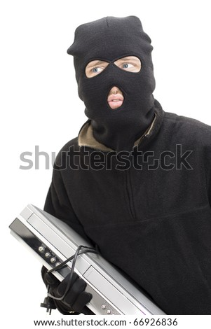 A Isolated Studio Shot Of Thieving Tom Looking A Little Panicked While Holding A DVD/Blue Ray Player - stock photo