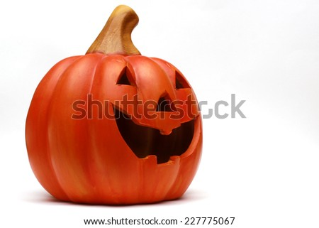 A Jack O Lantern made from clay depicting a smiling face - stock photo
