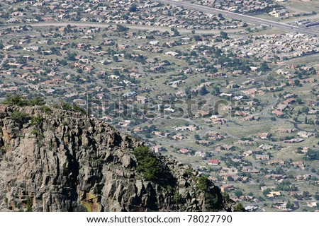 A jagged mountain abuts and limits urban sprawl in the arid southwestern desert , USA - stock photo