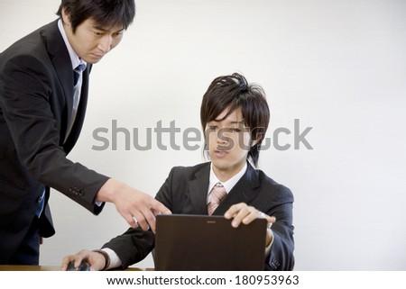 A Japanese businessman negotiating - stock photo
