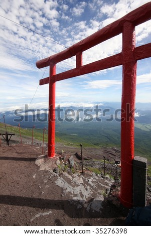 A Japanese tori gate above the clouds - stock photo