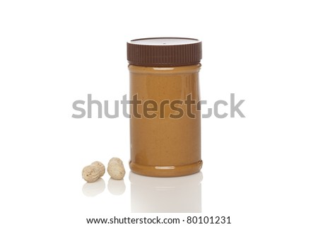 A jar of peanut butter against a white background - stock photo