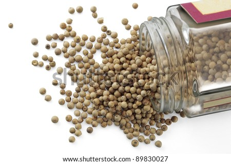A jar with white peppercorns isolated over a white background - stock photo