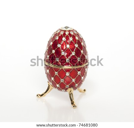 A jewel red egg with precious gems and stones - stock photo