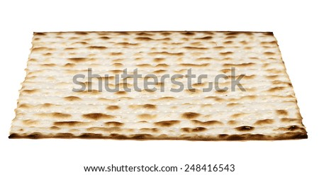 A Jewish Matzah bread, the substitute for bread on the Jewish Passover holiday, isolated on white background. - stock photo