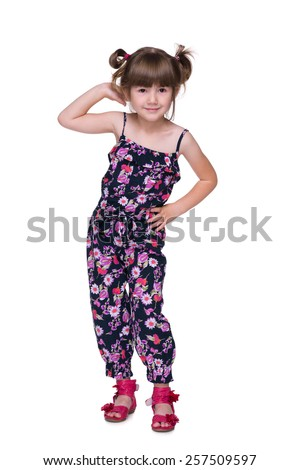 A joyful preschool girl is standing on the white background - stock photo