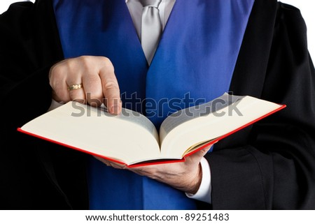 a judge with a law book in court. against a white background - stock photo