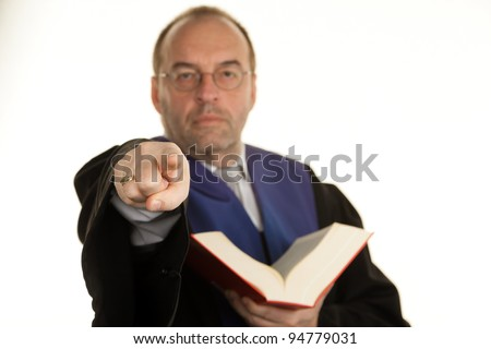 a judge with a law book in court. book in hand. - stock photo
